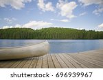 A Canoe On A Wooden Dock Facing ...