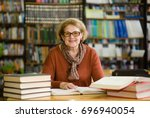 happy senior woman with books... | Shutterstock . vector #696940054