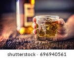 Small photo of Alcoholism.Hand alcoholic and drink the distillate whiskey brandy or cognac.