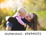 a young mother walks with a...   Shutterstock . vector #696944251