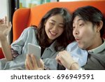 younger asian man and woman... | Shutterstock . vector #696949591