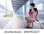 asian chinese mother and... | Shutterstock . vector #696952327