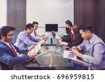 group of asian business people... | Shutterstock . vector #696959815