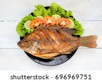 fried fish with vegetable on... | Shutterstock . vector #696969751