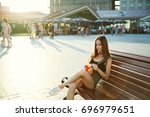 young girl with cheeseburger... | Shutterstock . vector #696979651