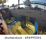 submarine cable loading | Shutterstock . vector #696995341