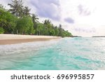 beautiful sea beach at tropical ... | Shutterstock . vector #696995857