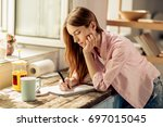 portrait of young girl writing... | Shutterstock . vector #697015045