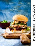 asian style salmon burger with... | Shutterstock . vector #697016005