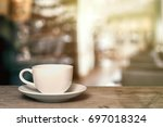 white coffee cup on wooden... | Shutterstock . vector #697018324