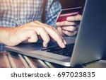 man's hand typing on keyboard... | Shutterstock . vector #697023835