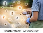 woman use controller and smart... | Shutterstock . vector #697029859