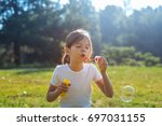pleasant little girl playing... | Shutterstock . vector #697031155