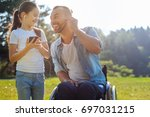 father with mobility impairment ... | Shutterstock . vector #697031215
