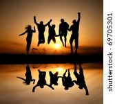 silhouette of friends jumping...