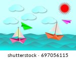 sailboat and colorful plane... | Shutterstock .eps vector #697056115