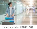young asian man walking with... | Shutterstock . vector #697061509