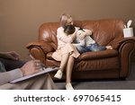 family psychotherapy. mother... | Shutterstock . vector #697065415