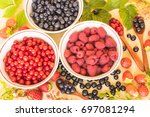 fresh and colorful berries... | Shutterstock . vector #697081294