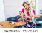 outdoor portrait of  stylish... | Shutterstock . vector #697091134