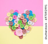 colorful buttons heart on color ... | Shutterstock . vector #697092991