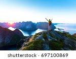 happy woman hiker enjoying... | Shutterstock . vector #697100869
