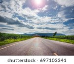 long road and blue sky on day... | Shutterstock . vector #697103341