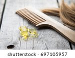 hair nourishment. vitamin serum ... | Shutterstock . vector #697105957