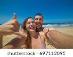 crazy couple friends take photo ... | Shutterstock . vector #697112095