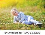 little girl lies on grass in...   Shutterstock . vector #697132309