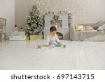 cute toddler playing with his... | Shutterstock . vector #697143715