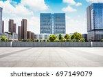 modern skyline and empty road   Shutterstock . vector #697149079