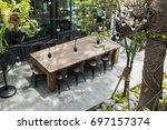 dining table in backyard garden ... | Shutterstock . vector #697157374