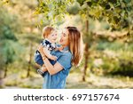 Mom Holds A Small Child In The...