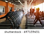 Row of treadmills in modern fitness center. Blurred picture of Running people. Gym equipment. - stock photo