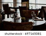 dining table served with... | Shutterstock . vector #697165081
