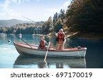 two men relaxing and fishing  | Shutterstock . vector #697170019
