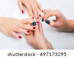 girl do a manicure and paint... | Shutterstock . vector #697173295
