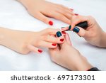 girl do a manicure and paint... | Shutterstock . vector #697173301
