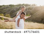 father playing with his son... | Shutterstock . vector #697176601