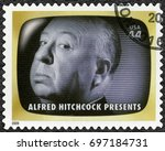 Small photo of NORTH HOLLYWOOD, UNITED STATES OF AMERICA - AUGUST 11, 2009: A stamp printed in USA shows portrait of Sir Alfred Joseph Hitchcock (1899-1980), Alfred Hitchcock Presents, Early TV Memory, 2009