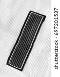 black textile clothes label on... | Shutterstock . vector #697201537