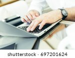 young man performs work on a... | Shutterstock . vector #697201624
