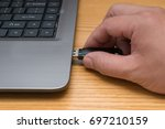 hand putting a usb flash drive... | Shutterstock . vector #697210159