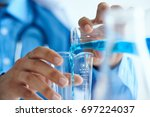 medical experiments close up    ... | Shutterstock . vector #697224037
