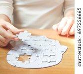 female hands holding missing... | Shutterstock . vector #697226665