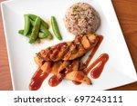 chicken steak  fried rice and... | Shutterstock . vector #697243111