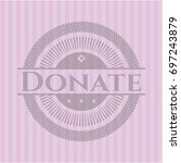 donate badge with pink... | Shutterstock .eps vector #697243879
