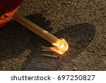 light the fire with the sun... | Shutterstock . vector #697250827