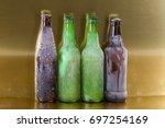 frozen beer bottles on a gold... | Shutterstock . vector #697254169